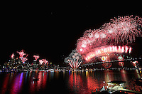 SYDNEY, AUSTRALIA - JANUARY 01:  Fireworks light up the skyline over Sydney Harbour during the midnight fireworks session as Sydney Celebrates New Year's Eve with the theme of 'Time To Dream' on January 1, 2012 in Sydney, Australia.  (Photo by Marianna Massey/WireImage)
