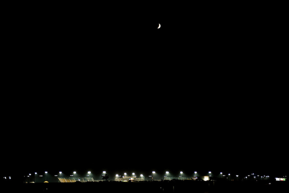 NEWTON, IOWA. -AUG. 1, 2014: The moon rises over Iowa Speedway Friday, Aug. 1, 2014. Lauren Justice for The New York Times