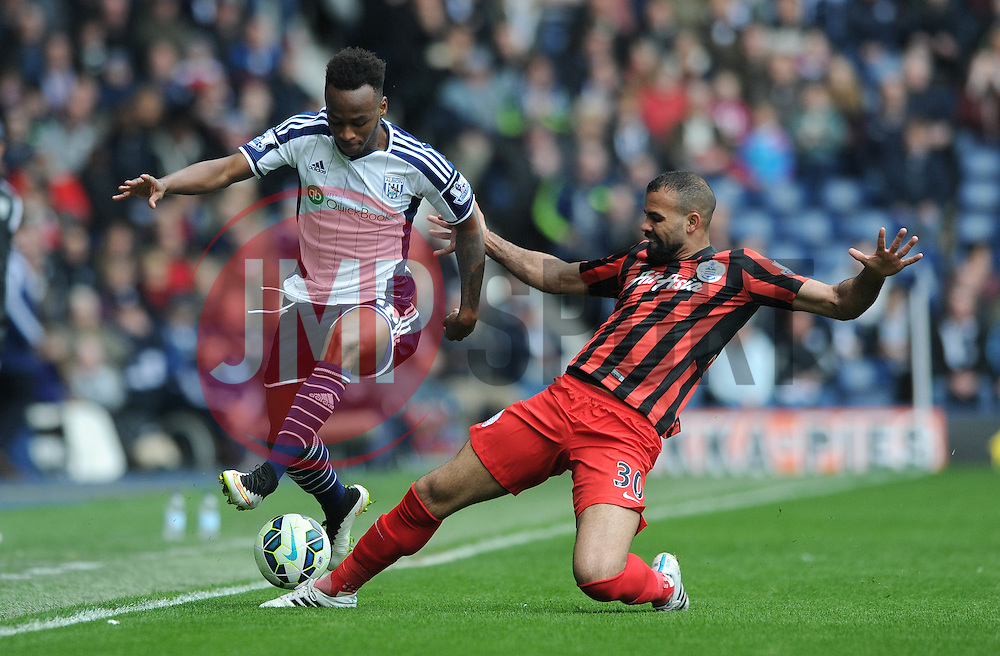 West Bromwich Albion's Saido Berahino is tackled by Queens Park Rangers' Sandro - Photo mandatory by-line: Dougie Allward/JMP - Mobile: 07966 386802 - 04/04/2015 - SPORT - Football - West Bromwich - The Hawthorns - West Bromwich Albion v QPR - Barclays Premier League