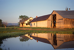 Rustic barn and house and small pond in New Mexico