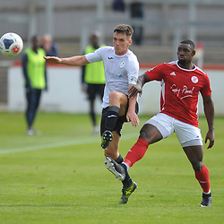 TELFORD COPYRIGHT MIKE SHERIDAN Ross White of Telford and Lee Ndlovu during the National League North fixture between Brackley Town and AFC Telford United at St James's Park on Saturday, September 7, 2019<br /> <br /> Picture credit: Mike Sheridan<br /> <br /> MS201920-016