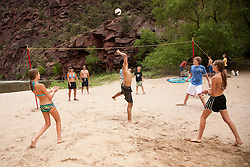 North America, United States, Colorado, Dinosaur National Monument, Green River (Gates of Lodore section), volleyball game on beach in canyon.  MR