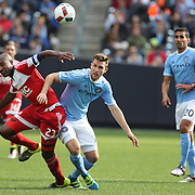 Jose Goncalves, New England Revolution and Patrick Mullins, (right), NYCFC, challenge for the ball during the New York City FC Vs New England Revolution, MSL regular season football match at Yankee Stadium, The Bronx, New York,  USA. 26th March 2016. Photo Tim Clayton