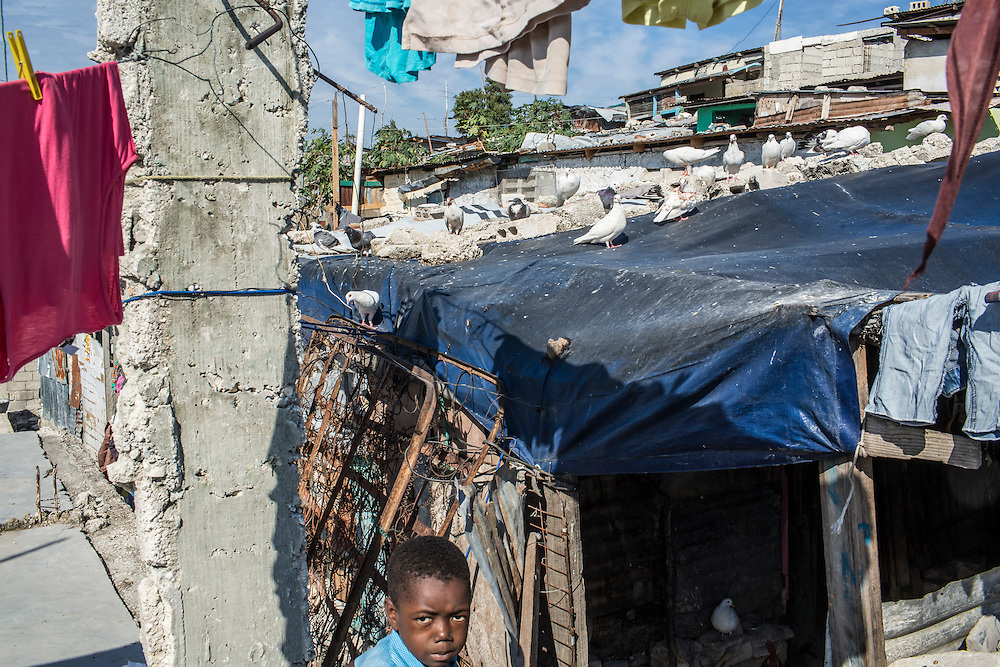 A boy in the Fort National neighborhood on Tuesday, December 16, 2014 in Port-au-Prince, Haiti. One of Port-au-Prince's poorer neighborhoods, Fort National was among the hardest hit by the 2010 earthquake. Still, its residents lack electricity or running water, and only several new homes have been built by the aid organizations and the government, despite years of promises.