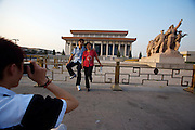 Tian'anmen Square (Place of Heavenly Peace). Mao Zedong Mausoleum. Chinese tourists shooting souvenir photos.