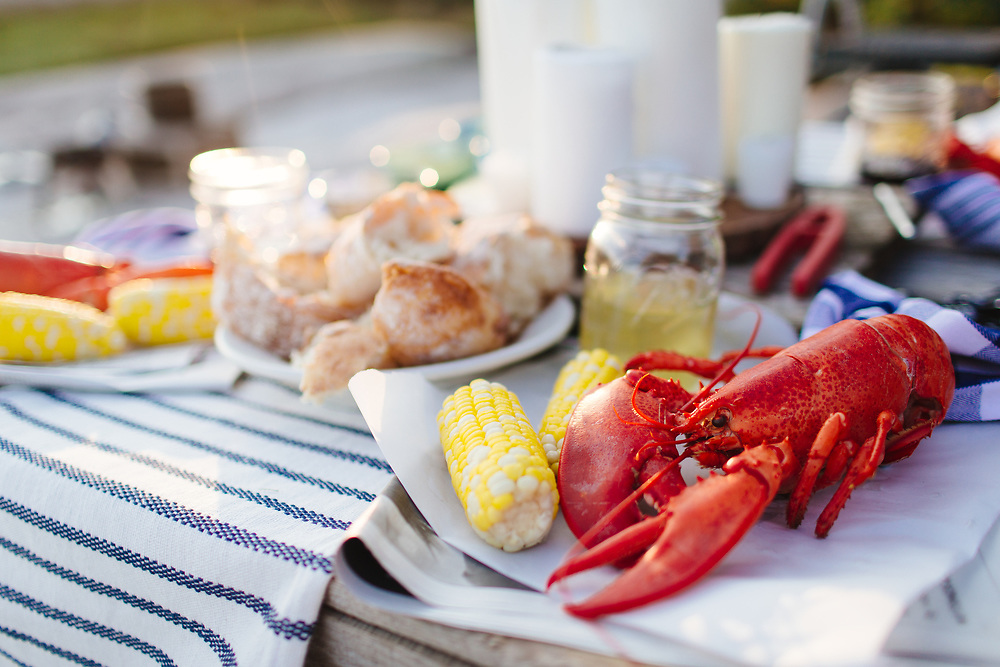 Lobsters and corncobs outdoors