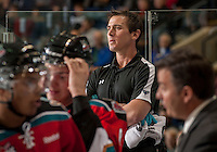 KELOWNA, CANADA - OCTOBER 10: Jeff Thorburn, Athletic Therapist for the Kelowna Rockets stands on the bench opposite the Spokane Chiefs at the Kelowna Rockets on October 10, 2012 at Prospera Place in Kelowna, British Columbia, Canada (Photo by Marissa Baecker/Shoot the Breeze) *** Local Caption ***