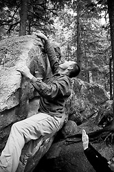 Climbers bouldering at the base of the Stawamus Chief in Squamish, BC