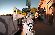 A protestor addresses participants in the annual All Souls Procession honor the deceased in Tucson, Arizona, USA.