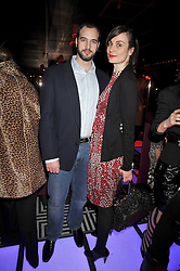 MARIA CASTANI and KYRIAKOS ORFANIDIS at a party following the Issa fashion show at the February 2009 Fashion Week held at Raffles, King's Road, London on 23rd February 2009.
