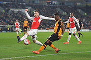 Hull City midfielder Moses Odubajo (2) crosses the ball deflected by Calum Chambers of Arsenal FC (21)  during the The FA Cup fifth round match between Hull City and Arsenal at the KC Stadium, Kingston upon Hull, England on 8 March 2016. Photo by Ian Lyall.