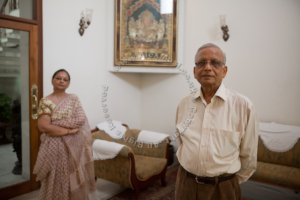S.M. Khandelwal, (right) the renown Agra businessman and former chairman of the Taj Trapezium Struggle Committee, is standing with his wife (left) inside the living-room of their Agra home.