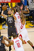 Golden State Warriors guard Stephen Curry (30) shoots an off-balance shot against the Houston Rockets in the final seconds of the first half during Game 4 of the Western Conference Finals at Oracle Arena in Oakland, Calif., on May 22, 2018. (Stan Olszewski/Special to S.F. Examiner)