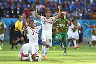 Giancarlo González (left) and Cristian Gamboa of Costa Rica celebrate victory during the 2014 FIFA World Cup match at Itaipava Arena Pernambuco, Recife metropolitan area<br /> Picture by Stefano Gnech/Focus Images Ltd +39 333 1641678<br /> 20/06/2014