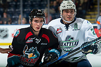 KELOWNA, CANADA - OCTOBER 10:  Matthew Wedman #21 of the Seattle Thunderbirds checks Liam Kindree #26 of the Kelowna Rockets during second period on October 10, 2018 at Prospera Place in Kelowna, British Columbia, Canada.  (Photo by Marissa Baecker/Shoot the Breeze)  *** Local Caption ***