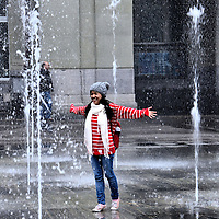 """Young Woman Dancing in Federal Square Fountain in Bern, Switzerland <br /> This happy young woman skipping through the """"dancing waters"""" of the 26 jet fountain in Federal Square, also called Bundesplatz, is in the heart of Bern's largest city square.  It faces the Federal Parliament building and the headquarters for Switzerland's central bank.  It is also the site of countless political rallies, concerts and a bi-weekly flower and produce market."""