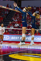 BLOOMINGTON, IL - September 15: Elizabeth Orf blocks the ball back to the Redbirds side of the court during a college Women's volleyball match between the ISU Redbirds and the Marquette Golden Eagles on September 15 2019 at Illinois State University in Normal, IL. (Photo by Alan Look)