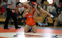 Virginia's Mike Sewell handles Ohio State's Steve Sommer.  Sewell lost the match 6-3, and UVA lost the meet 28-10.