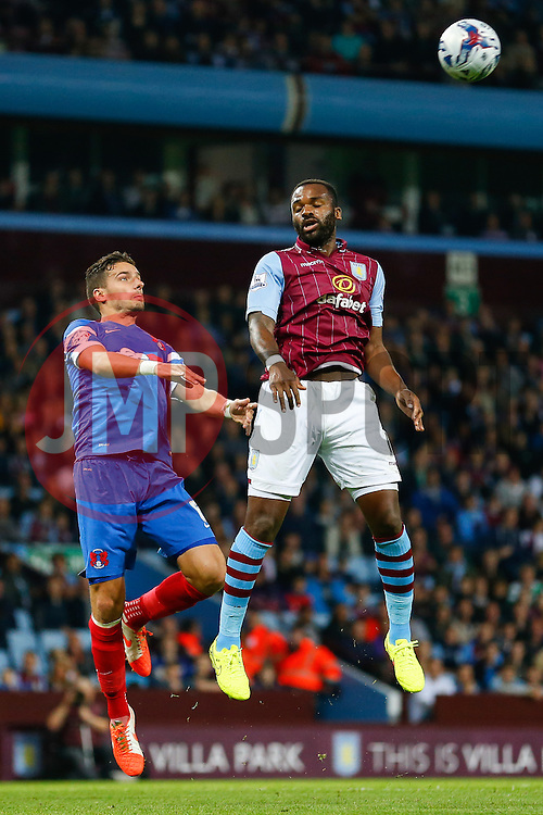 Darren Bent of Aston Villa cant quite connect with a cross as Mathieu Baudry of Leyton Orient challenges in the air - Photo mandatory by-line: Rogan Thomson/JMP - 07966 386802 - 27/08/2014 - SPORT - FOOTBALL - Villa Park, Birmingham - Aston Villa v Leyton Orient - Capital One Cup Round 2.