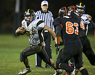 Midland's Ryan Leonard (7) tries to avoid Springville's Cody Blake (63) and Drake Coonrod (41) on a run during their game at Allison Field in Springville on Friday October 19, 2012. Midland defeated Springville 30-29.