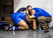 Leo Crosby, a senior at Zanesville High School, is embraced by his coaches, Chris Miller andPat Lawson after failing to qualify for the final match at the 2016 state wrestling finals. Crosby was the wrestler from his school to qualify for the state meet in over 40 years. This year was his second and final chance to make the podium, but he fell just short of making the cut.