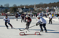 Barry Enos goes for the goal during the Looney Bin's matchup with Safety Third in Twig division Pool Play Saturday afternoon during New England Pond Hockey.  (Karen Bobotas/for the Laconia Daily Sun)