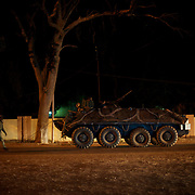 January 19, 2013 - Niono, Mali: Mali troops tow a broken Armoured Personal Carrier in central Niono. Niono is the last government controlled location before Diabaly, a city under islamist militants control since the 14th of January...Several insurgent groups have been fighting a campaign against the Malian government for independence or greater autonomy for northern Mali, an area known as Azawad. The National Movement for the Liberation of Azawad (MNLA), an organisation fighting to make Azawad an independent homeland for the Tuareg people, had taken control of the region by April 2012...The Malian government pledge to the French army to help the national troops to stop the rebellion advance towards the capital Bamako. The french troops started aerial attacks on rebel positions in the centre of the country and deployed several hundred special forces men to counter attack the advance on the ground. (Paulo Nunes dos Santos/Polaris)