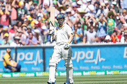 © Licensed to London News Pictures. 27/12/2013. Chris Rodgers raises his bat after making his 50  during Day 2 of the Ashes Boxing Day Test Match between Australia Vs England at the MCG on 27 December, 2013 in Melbourne, Australia. Photo credit : Asanka Brendon Ratnayake/LNP