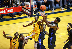 Nov 9, 2018; Morgantown, WV, USA; West Virginia Mountaineers forward Wesley Harris (21) and Buffalo Bulls forward Nick Perkins (33) jump for a rebound during the first half at WVU Coliseum. Mandatory Credit: Ben Queen-USA TODAY Sports