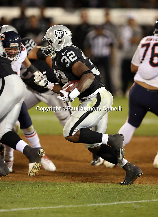 Oakland Raiders fullback Jeremy Stewart (32) runs for a 22 yard gain and a fourth quarter first down during the NFL preseason week 3 football game against the Chicago Bears on Friday, Aug. 23, 2013 in Oakland, Calif. The Bears won the game 34-26. ©Paul Anthony Spinelli
