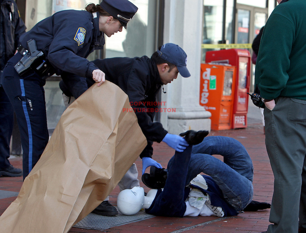 A mannequin is packaged as evidence by police after a bomb Scare in Boston's Kenmore Square aimed at Bank of America.