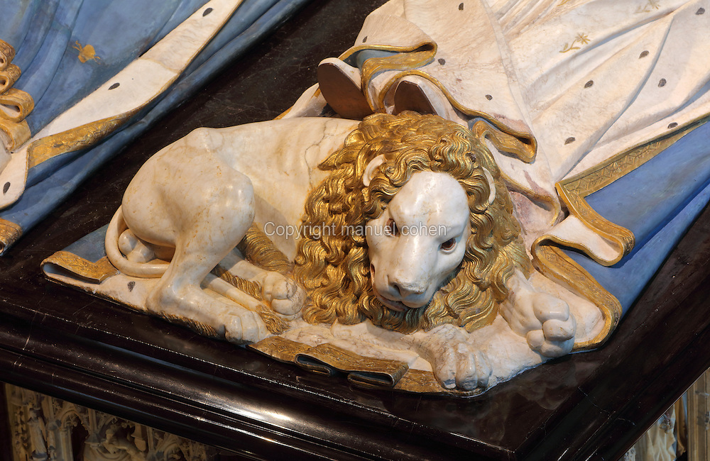 Lion at the feet of Margaret of Bavaria, from the tomb of Jean sans Peur, or John the Fearless, 1371-1419, (Jean de Valois or John of Valois, Jean I, duc de Bourgogne, or John I, Duke of Burgundy) and his wife Marguerite de Baviere, or Margaret of Bavaria, 1363- 1423, 1443-70, by Jean de la Huerta, 1413-62, and Antoine le Moiturier, 1425-97, in the Grande Salle du Palais des ducs de Bourgogne, or Salle des Gardes, a 15th century Flamboyant Gothic hall, in the Musee des Beaux-Arts de Dijon, opened 1787 in the Palace of the Dukes of Burgundy in Dijon, Burgundy, France. The tomb consists of painted alabaster effigies with lions and angels, and below, figures of pleurants or weepers among Gothic tracery. The tomb was begun in 1443 (24 years after his death), by Jean de La Huerta, and Antoine le Moiturier after 1456, and finally installed in 1470. The tombs were originally from the Chartreuse de Champmol, or Chartreuse de la Sainte-Trinite de Champmol, a Carthusian monastery which was sacked in the French Revolution and the tombs moved to Dijon cathedral then here in 1827. The effigies are 19th century reconstructions, the originals being destroyed in the French Revolution. Picture by Manuel Cohen