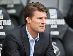 SWANSEA, WALES - Saturday, September 28, 2013: Swansea City's manager Brian Laudrup before the Premiership match against Arsenal at the Liberty Stadium. (Pic by David Rawcliffe/Propaganda)