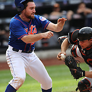 Daniel Murphy, New York Mets, is tagged out at home plate as he collides with Miami Marlins catcher Rob Brantly during the New York Mets V Miami Marlins, Major League Baseball game which went for 20 innings and lasted 6 hours and 25 minutes. The Marlins won the match 2-1. Citi Field, Queens, New York. 8th June 2013. Photo Tim Clayton