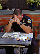 "A police officer hangs his head as he readds the news about Grund Zero three days after the attack. Through my eyes and with my camera I am able to see the world we live in, and try to bring things into focus. Photography preserves my vision of what ""I see"" at a specific time and place- a moment. Creating a bond between  me and my subject and capturing and emotion for eternity. Having lived and worked in New York City for over 15 years when 911 happened. I had to go and ""see"" with my camera what lower Manhattan was like after this horrific attack on our Nation. The World Trade Center owned the skyline in lower Manhattan making it feel more like a canyon. After the Twin Towers fell, and I saw with my own eyes and camera the destruction, I realized what little land they actually sat on. The Twin Towers may not have occupied a large plot of land but they now touched everyones life. Photo©SuziAltman"