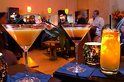 The bar/lounge of NV Restaurant in Napa, California. Drinks left to right are: Tantaliziång Mandarin, Un-tie My-tie, and Rick's Perfect Pineapple.