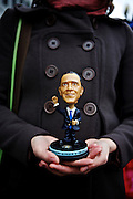 Magali Barthes, a television journalist from Paris, buys a bobblehead of President Barack Obama from a street vendor near the White House on Nov. 7, 2012. Barthes covered the election for the past ten days in Washington, D.C. and decided to buy some mementos to remember the experience.