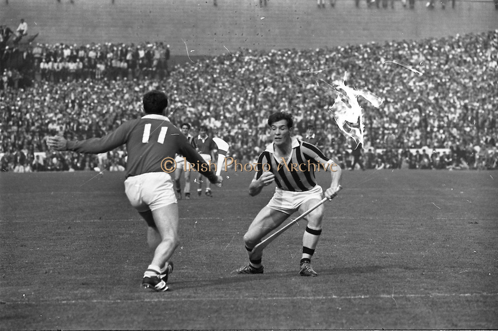 07/09/1969<br /> 09/07/1969<br /> 7 September 1969<br /> All-Ireland Senior Hurling Final: Kilkenny v Cork at Croke Park, Dublin.  <br /> P.O. Dulainne (Kilkenny forward) with the ball tries to get past Cork forward, C.O. Cuilleanain (11).