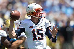 PASADENA, CA - SEPTEMBER 05:  Quarterback Matt Johns #15 of the Virginia Cavaliers passes against the UCLA Bruins during the second quarter at the Rose Bowl on September 5, 2015 in Pasadena, California. The UCLA Bruins defeated the Virginia Cavaliers 34-16. (Photo by Jason O. Watson/Getty Images) *** Local Caption *** Matt Johns