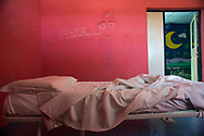 Roma, 19/07/2016: Il reparto degenza del dipartimento di Neuropsichiatria infantile in via dei Sabelli - Writings on the wall says &quot;is not that I never cry is that tears pull down inside me&quot;. Bedroom of the Early Psychosis ward of Child Neuro Psychiatry.<br />