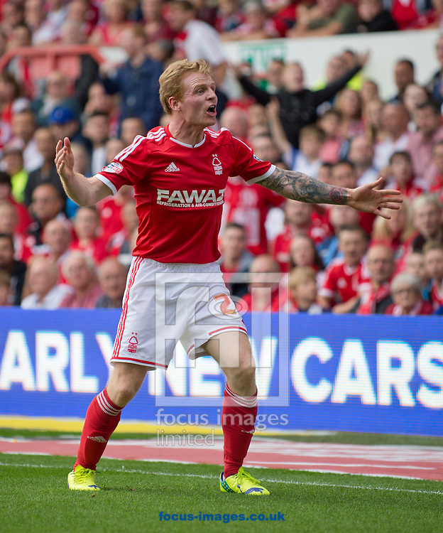 Chris Burke of Nottingham Forest reacts angrily during the Sky Bet Championship match at the City Ground, Nottingham<br /> Picture by Russell Hart/Focus Images Ltd 07791 688 420<br /> 14/09/2014