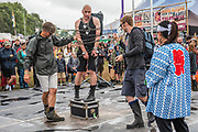 A crowd enjoys watching escapologist Rob Roy - The 2017 Glastonbury Festival, Worthy Farm. Glastonbury, 24 June 2017