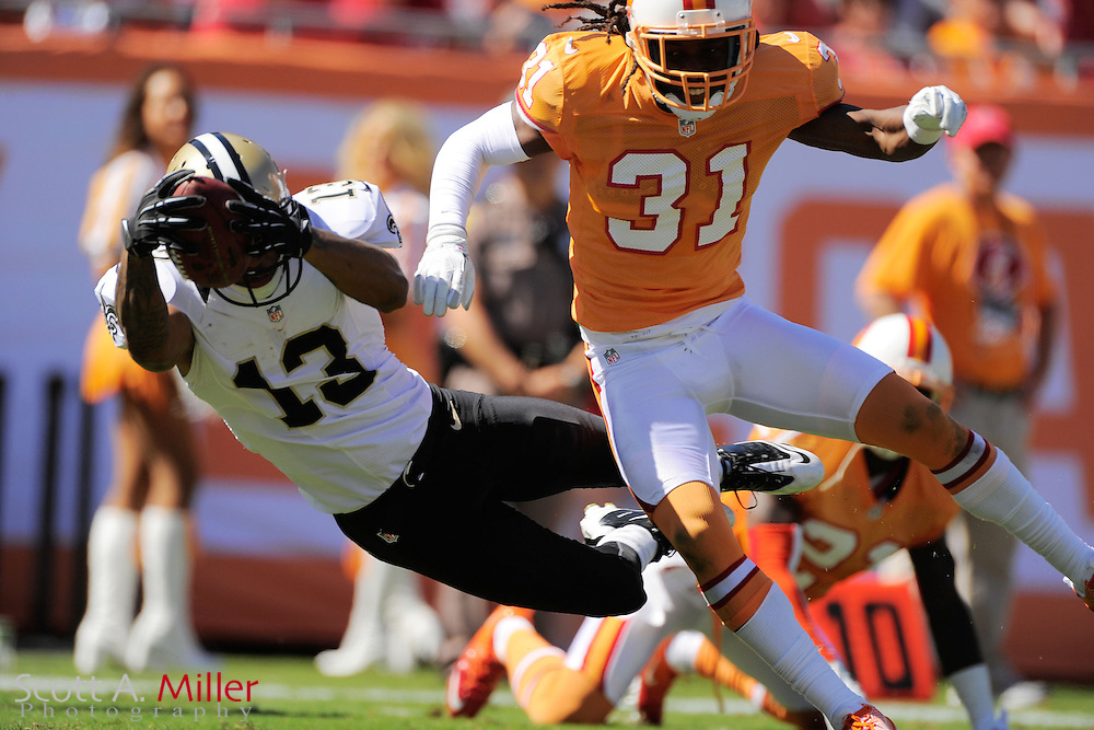 New Orleans Saints wide receiver Joe Morgan (13) dives in for a touchdown as Tampa Bay Buccaneers cornerback E.J. Biggers (31) defends during their game at Raymond James Stadium  on Oct. 21, 2012 in Tampa, Florida. ...©2012 Scott A. Miller...