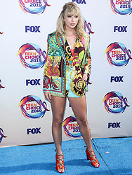 HERMOSA BEACH, LOS ANGELES, CALIFORNIA, USA - AUGUST 11: Singer Taylor Swift wearing a Versace bodysuit, shorts and blazer with Kat Maconie shoes, Misahara earrings, and rings by Irene Neuwirth, VRAM, and Emily P Wheeler arrives at FOX's Teen Choice Awards 2019 held at the Hermosa Beach Pier Plaza on August 11, 2019 in Hermosa Beach, Los Angeles, California, United States. 11 Aug 2019 Pictured: Taylor Swift. Photo credit: Xavier Collin/Image Press Agency/MEGA TheMegaAgency.com +1 888 505 6342
