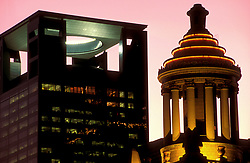 Stock photo of the Centerpoint Energy Plaza building on left and Niels Esperson Building on right at night in Houston, Texas