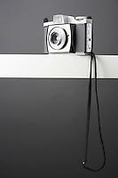 Vintage photo camera on shelf studio shot