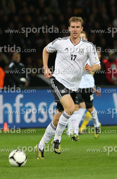 16.10.2012, Olympia Stadion, Berlin, GER, FIFA WM Qualifikation, Deutschland vs Schweden, im Bild Per MERTESACKER (Deutschland) // during the FIFA World Cup Qualifier Match between Germany and Sweden at the Olympic Stadium, Berlin, Germany on 2012/10/16. EXPA Pictures © 2012, PhotoCredit: EXPA/ Eibner/ Eckhard Eibner..***** ATTENTION - OUT OF GER *****