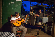 Matagalpa, Nicaragua, May 2014. Entertainment at our homestay. We overnight at a homestay in La Corona village. The people own, or work in, small familiy coffee plantations that sell their Arabica coffee via Sol Cafe, a Fair Trade cooperative. Matagalpa tours offers trips to coffee plantations and remote villages, rural community tourism, agro-tourism, hiking and biking. Central America's largest and least populated country consists of lakes; volcanoes and Spanish colonial cities. Photo by Frits Meyst / MeystPhoto.com