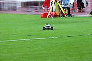 30.6.2012, Olympiastadion - Olympic Stadium, Helsinki, Finland..European Athletics Championship - Yleisurheilun EM-kisat..Heittopaikan kauko-ohjattava välineiden kuljetusauto vauhdissa sateisella nurmella.