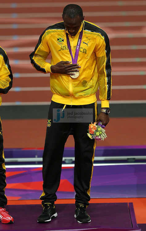 Usain Bolt of Jamaica celebrates with his gold medal after winning the men's 4x100 relay race at the Olympic stadium during day 15 of the London Olympic Games in London, England, United Kingdom on August 11, 2012..(Jed Jacobsohn/for The New York Times)..